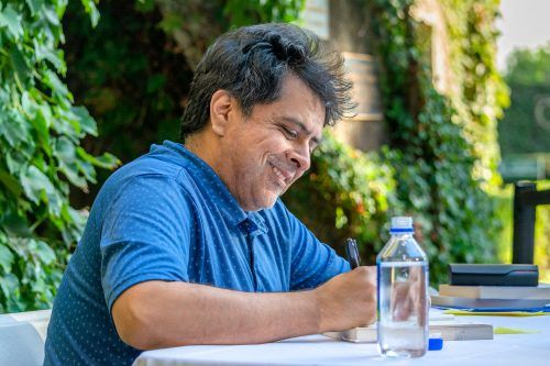 "Author Brando Skyhorse signs copies of his memoir ""Take This Man"" after his One Book, One University keynote lecture Wednesday in Fasnacht Court. / photo by Veronyca Norcia"