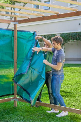 Daniel Loera, director of the office of multicultural services, and Ryan Konrad, freshman political science major, help build the Sukkah in honor of Sukkot on Oct. 11 in Sneaky Park. / photo by Veronyca Norcia