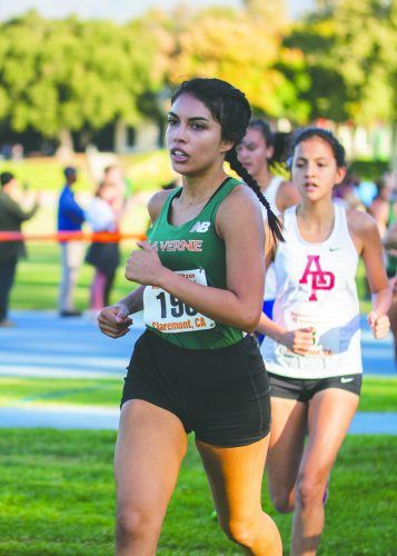 Senior Bianca Page runs the women's 6K race at the Pomona-Pitzer Invitational Saturday. The women's squad took eighth at the event, with strong performances from junior Ashley Garnica, senior Catherina Posada and junior Reiko Fujimoto. / photo by Nathan Hua