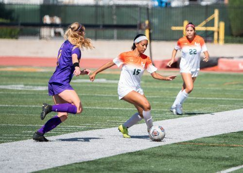 Leopards freshman defender Jordyn Beaulieu dribbles past Regals sophomore defender Danielle Vis in La Verne's game against Cal Lutheran on Saturday at Ortmayer Stadium. The Leopards would go on to lose, 4-1, with Beaulieu scoring La Verne's only goal. / photo by Nathan Hua