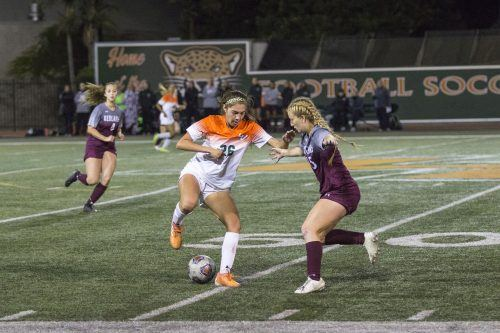 Leopards freshman forward Sarah Ramirez tries to maneuver the ball past Bulldogs sophomore defender Ashley Holbrook at Ortmayer Stadium on Wednesday. La Verne won the game against Redlands 1-0. With the win La Verne improves to 2-8-1 in SCIAC.