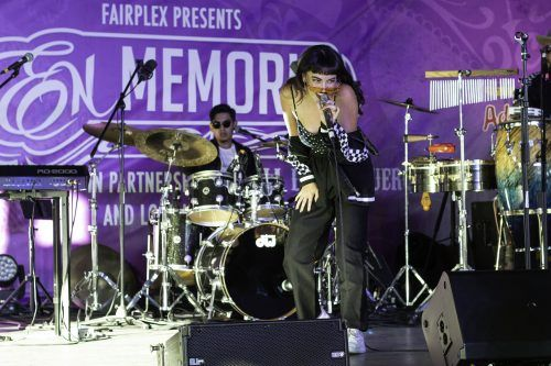 Veronica Rosa, singer for the band Introverted Funk, performs a song at the En Memoria event at the Fairplex Saturday. This Dia de los Muertos celebration brings together Latino artwork and culture with the low rider community. / photo by Melody Blazauskas