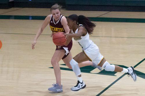 Sophomore guard for the Leopards, Jazzlyn Johnson, pushes through Buccaneers guard Daniela Bernal in ULV's game against Park University on Friday night. The Leopards came up short in the double overtime thriller 107-105.