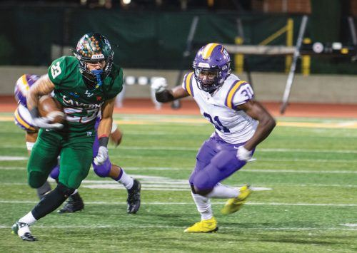 Senior Leopards running back James Gonsalves cuts past junior Kingsmen cornerback Obasi Dees. The Leopards mustered just 37 rushing yards against Cal Lutheran, losing 20-15. The Leopards return to play Chapman in their final game on Saturday. / photo by Maydeen Merino