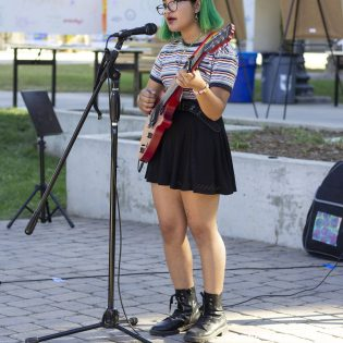 Iris Dallas performing at Rallying Cry on Saturday in Sneaky Park. The event was part of senior theater arts major Mallorie Johnson's senior project to help Joyful Heart's Policy and Advocacy program called End the Backlog as a way to raise awareness of the backlog of rape kits.