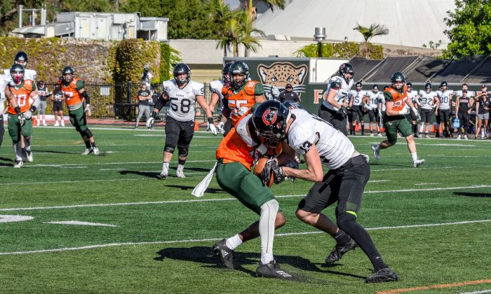 Leopards senior cornerback Torii Hilbert runs the ball through Panthers sophomore receiver Spencer Corona after picking off junior quarterback Jonston Macintyre in La Verne's final game against Chapman on Saturday. The Leopards fell on Senior Day, 28-17.