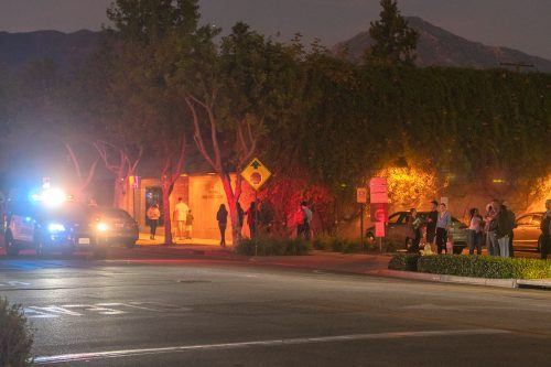 University of La Verne students gather around D Street and Arrow Highway to see the area where a student was hit by a car while jaywalking Monday evening. The student did not need to be taken to the hospital but was left with bumps and bruises. / photo by Veronyca Norcia