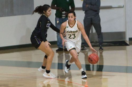 Senior Leopards forward Destinee Garcia works the ball around junior Poets guard Daisy Cardenas during La Verne's SCIAC opener against Whittier Wednesday night. La Verne won 78-72.