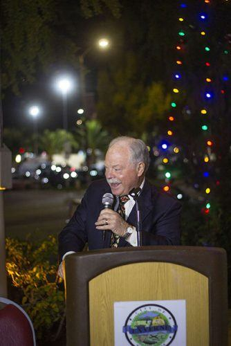 Mayor Don Kendrick speaks before the annual Christmas tree lighting outside of the La Verne City Hall on Monday. The event gather the community to celebrate the holiday season. / photo by Eric Rangel