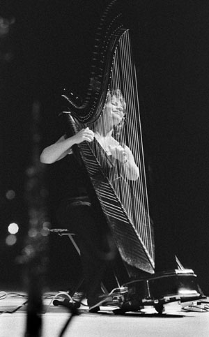 Despite its reputation, Lori Andrews showed that harps are not only for producing sweet, angelic music. Playing a wide variety of songs by Chick Corea, Horace Silver and a number of her own tunes, Andrews entertained and amazed Saturday night's crowd with the versatility of the electric harp. She was joined by three other musicians on saxophone, bass and drums. The free concert was held in Dailey Theatre for anyone interested in attending. / photo by Ian Gratz