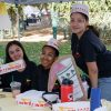 Freshman psychology major Maria Reynoso, freshman undeclared major Kaelyn Oliver and freshman music major Isobelle Garcia represent the Dance Club in In-In-Out gear at the spring club fair Feb. 5. / photo by Danielle De Luna