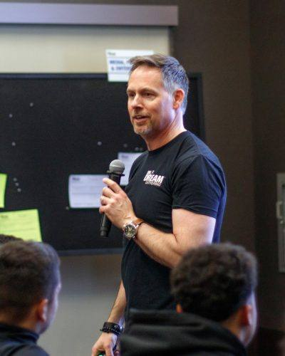 """Mitch Matthews, creator of the """"Dream. Think. Do."""" podcast, speaks to students the Campus Center Ballroom Tuesday. He came to motivate students to share their dreams and ideas with one another during  Career Services' BIG Dream Gathering. / photo by Danielle De Luna"""