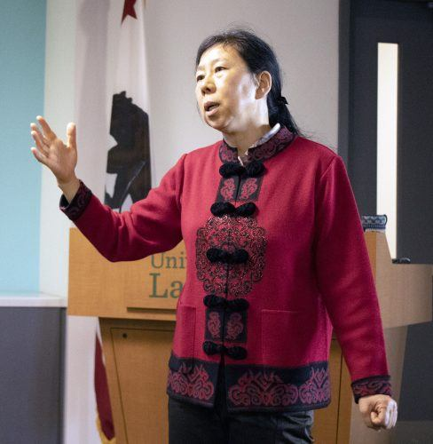 Xiaoyan Lin, professor of mathematics, speaks on the application of approximation theory to real life at the weekly faculty lecture Tuesday in the Quay Davis Executive Board Room. / photo by David Gonzalez