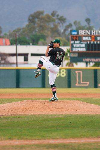 Starting pitcher Ben Aguilera winds up against Centenary on Sunday at Ben Hines Field. Aguilera threw 3.2 innings, surrendering three unearned runs with two strikeouts. / photo by Rachel Kendrick