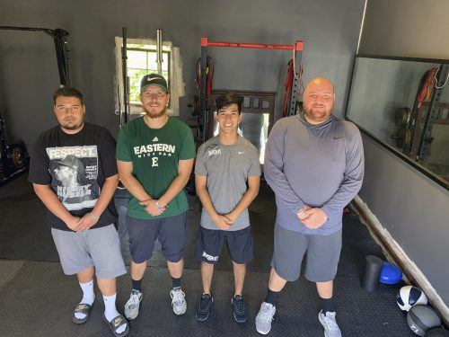 Nick Fierro, Shane Virnala, Arthur Romero and Daniel Fierro meet in Romero's makeshift gym to train together Thursday. / photo by Erica Rae Sanchez