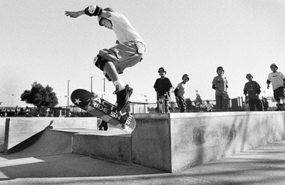 The new La Verne skate park is almost entirely concrete and consists of bowls, handrails, fun boxes and a pyramid jump. Jeff Johnson, 14, of Wrightwood attempts a kick flip off one of the fun boxes featured at the park. / photo by Matt Wright