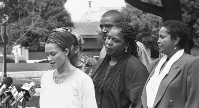 Along with her aunt Claudette (far right) and her close friends, Joju Younghi Cleaver, the daughter of former Black Panther Eldridge Cleaver, gave the local press a chance to hear the family's reaction to Cleaver's death two weeks ago from a heart attack. The press conference was followed by a memorial service honoring his life, featuring a message given by close friend Dr. Richard Rose, assistant professor of religion and philosophy. / photo by Scott Harvey