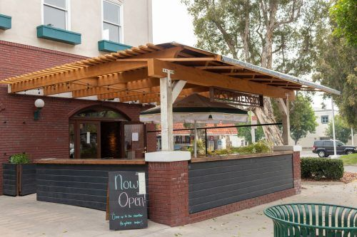 D Street Wienery, next door to Cactus Cafe in downtown La Verne, welcomes customers with its outdoor patio to enjoy a socially distanced upscale wiener. / photo by Christine Diaz