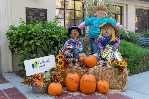 The Claremont Chamber of Commerce is hosting a Scarecrow Party through the month of October, allowing businesses and homeowners to decorate scarecrows to highlight the community of Claremont. The Children's Fund of the City of Claremont's entry sits in front of Claremont City Hall on Harvard Ave. in the Claremont Village. / photo by Christine Diaz