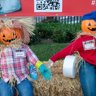 Lyla Lysol & Charlie Charmin scarecrows sit in front of the Seedling School on Harrison Avenue in Claremont. They are among the more than 90 scarecrows perched in front of homes and businesses through the month of October across the city, as for the Scarecrow Party. One of the safe Halloween festivities this year, the event which also includes a contest, is sponsored by the Claremont Chamber of Commerce. / photo by Christine Diaz