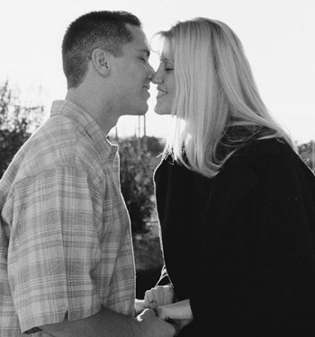 Kris Arellanes and Season Degner had originally planned to be married after graduation, but plans changed due to a lack of financial aid. Tomorrow, Arellanes and Degner will be wed with hopes that marital status will result in larger award letters. / photo by Starr Carroll
