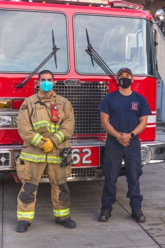 Probationary firefighters Davis Cook and Stephen Bautista stand at the ready for their next call at the La Verne Fire Department main headquarters at 2061 Third Street. The city is considering a switch and may soon be contracting with Los Angeles County Fire Department. / photo by Mya-Lin Lewis