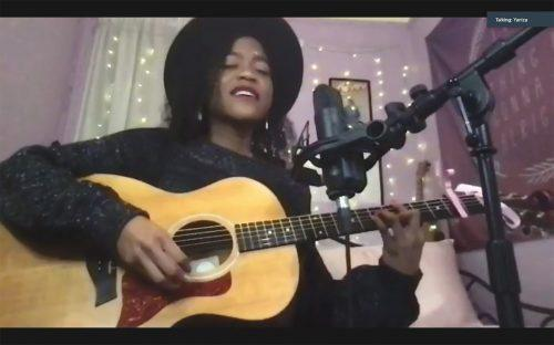 Singer-songwriter Yaniza performs her original songs as well as covers Feb. 18 at the Campus Activities Board's Origins of Rock and Roll event in celebration of Black History Month held via Zoom. Along with the performance, there was a brief presentation on the history of rock and roll music and the importance of Black artists in its development. / screenshot by Rachel Kendrick