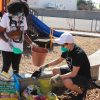 Juliana Pichay (right), justice resident for the Solid Rock Church, helps two volunteers fill their pots to start gardening on Saturday at the Community Garden event. The Solid Rock Church, located at 1364 N. Towne Ave. in Claremont, is starting a community garden at the church. / photo by Rachel Kendrick