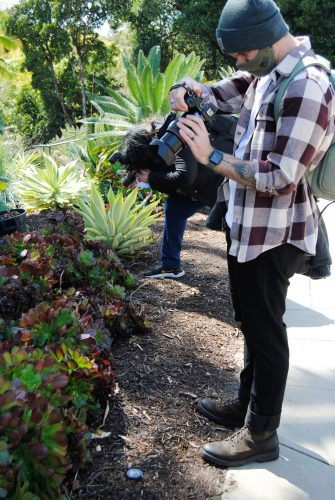 Photography Club president Brady Keegan and vice president Darcelle Jones-Wesley photograph in the Japanese garden at the Huntington Library in San Marino on March 15. / photo by Maddie Ybarra