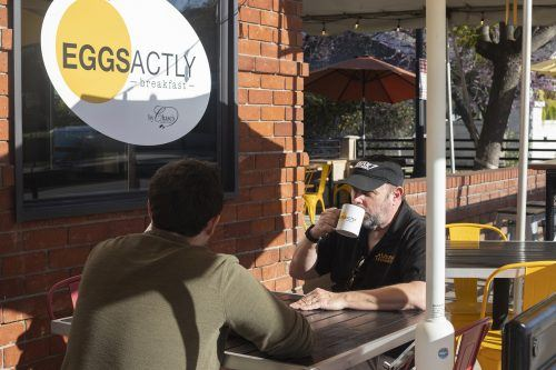 Sean Kerr and University of La Verne alumnus John Kerr eat breakfast at Eggsactly on the corner of D Street and Bonita Avenue in downtown La Verne. The restaurant is open for breakfast and brunch from 7 a.m. to 11 a.m. daily. / photo by Melody Blazauskas