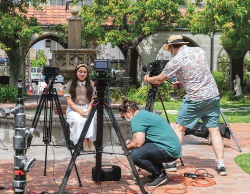 Alexys Ortiz, junior psychology major, poses for her close up during the filming of her solo performance for the Musical Theatre class final project Saturday at St. Mark's Episcopal Church in Glendale. Adjunct Professor Ariel Pisturino and videographer Phil Pritchard assist with the last minute adjustments. / photo by Rachel Kendrick
