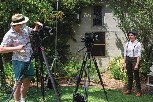 """Senior music major and Chamber Singers member Kate Correnti performs her solo """"Giants in the Sky"""" from """"Into The Woods"""" Saturday at St. Mark's Episcopal Church in Glendale. Videographer Phil Pritchard films the scene for the final project for the Musical Theatre course. / photo by Rachel Kendrick"""