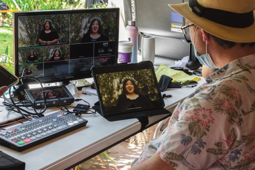 """Videographer Phil Pritchard reviews final shots from senior kinesiology major's Janelle Perez's solo performance of """"No One is Alone"""" from """"Into The Woods"""" for the Musical Theatre class's final project. The scenes were also filmed Saturday at St. Mark Espiscopal Church in Glendale. / photo by Rachel Kendrick"""