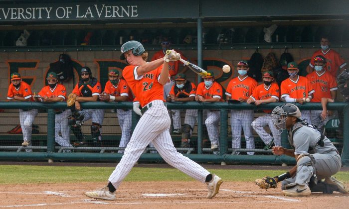 La Verne freshman third baseman Cameron Slessor battles through a prolonged at bat in the bottom of the first inning of the first game of Saturday's doubleheader against Redlands. He then blooped a single to center field to bring in La Verne's second run of the inning. It was one of his three hits he had in the game, including two triples, to go with his three RBIs. The Leopards beat the Bulldogs, 14-8, and swept the doubleheader to finish the pandemic-shortened season at 4-5. / photo by Emily Alvarez