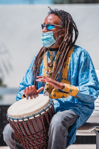 Ja-Amen beats the drum at the Rites of Passage event, which honors the circle of life, the journey of ancestors and one's personal journey in life, on Sept. 3 at the Ludwick Center. / photo by William Hardy