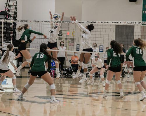 La Verne junior middle blocker Ayana Mier slams the ball against the St. Norbert College defense en route to a three set sweep against the Green Knights on Saturday. The match was part of the Pacific Coast Classic Tournament, hosted by La Verne. The Leopards finished the tournament 3-1 and will return to the court Friday for the Whittier College Invitational, which will also be co-hosted by ULV. / Photo by Shira O'Neal-Abend