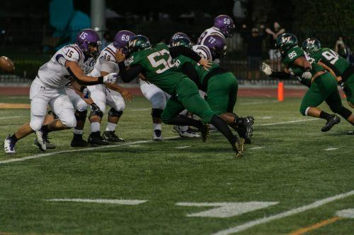 The Leopards' defensive line – led by senior Derek Shay (No. 52), senior Khary Sanders (No. 90), freshman Austin Marin (No. 95) and freshman Brandon Pedorza (No. 94) – strongly pressured the Poets offense, denying them any points on Saturday at Ortmayer Stadium. The football team dominated in its season opener, beating Whittier 42-0. The Leopards will pursue another win on the road against Chapman at 7 p.m. Saturday at Chapman Stadium. / Photo by Shira O'Neal-Abend