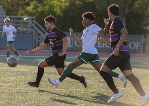 Leopard junior midfielder Owen Osagiede attempts to take the ball from Cal Lutheran senior midfielder Justin Magana during the Leopards' 2-0 loss to the Kingsmen on Sunday. The Leopards play George Fox and Whitman this weekend before beginning conference play next week. / photo by Shira O'Neal Abend