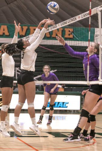 La Verne junior setter Jordyn Patton (9) looks to block the shot from Cal Lutheran's senior middle hitter Maci Haddaad (3) on Tuesday at Frantz Athletic Court. The women's volleyball team fell in straight sets to Cal Lutheran. The Leopards will take on Caltech at 7 p.m. Friday.