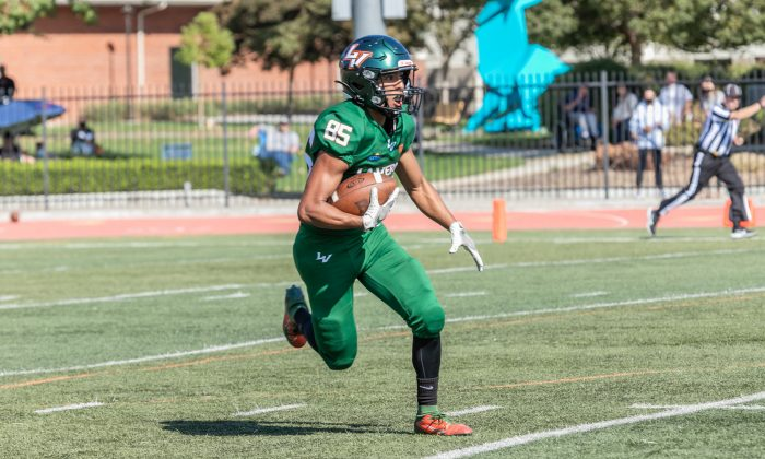 Senior kick returner Jacob Barriga (85) runs the ball down the field after receiving a kick from the Redlands special teams Saturday at Ortmayer Stadium. The Leopards lost to the Bulldogs, 51-7. They will recollect after their bye week this week and return to face Whittier on the road Oct. 23.